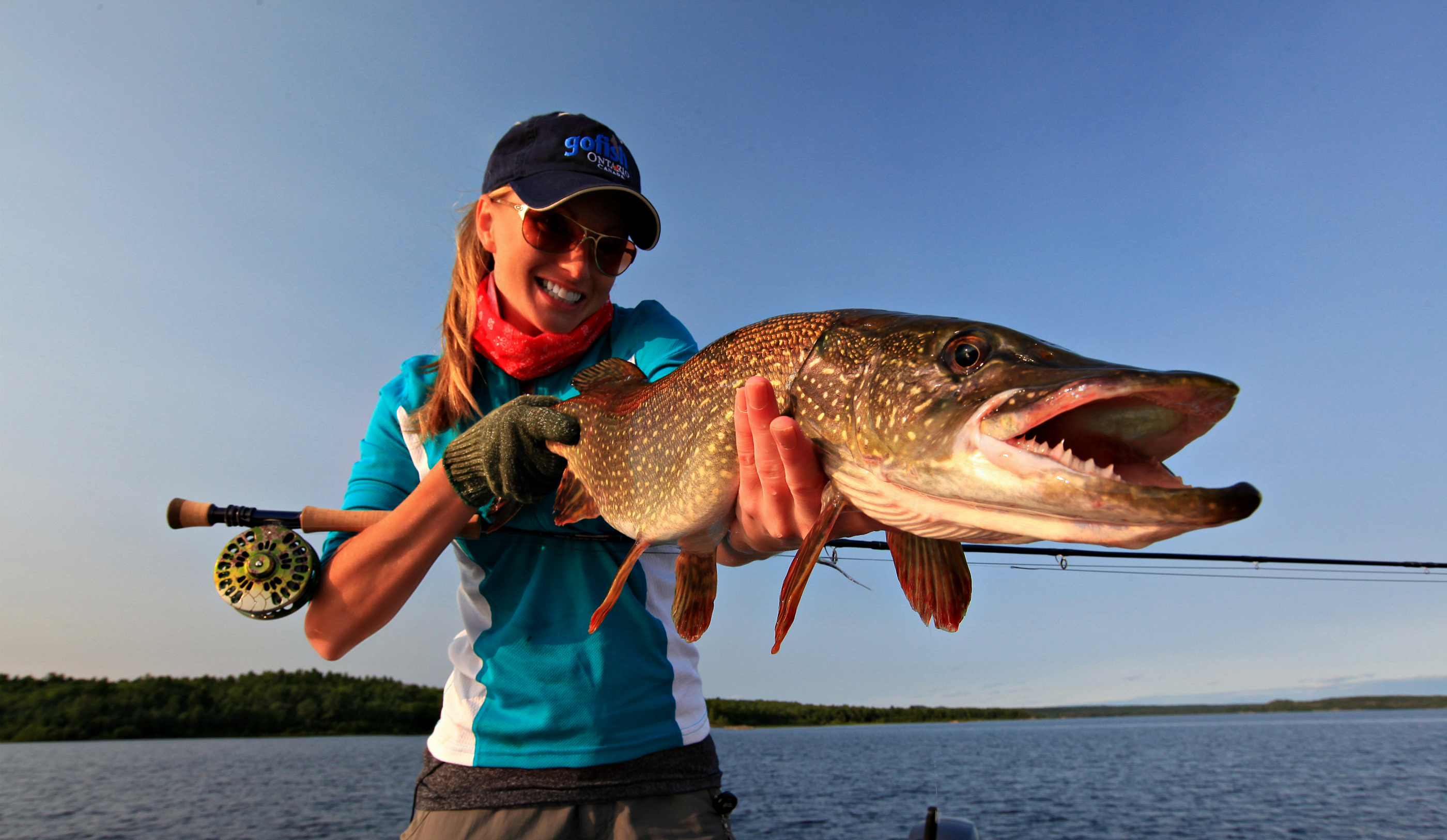 Photos of the day rebekka red reels them in orvis news for Orvis fly fishing