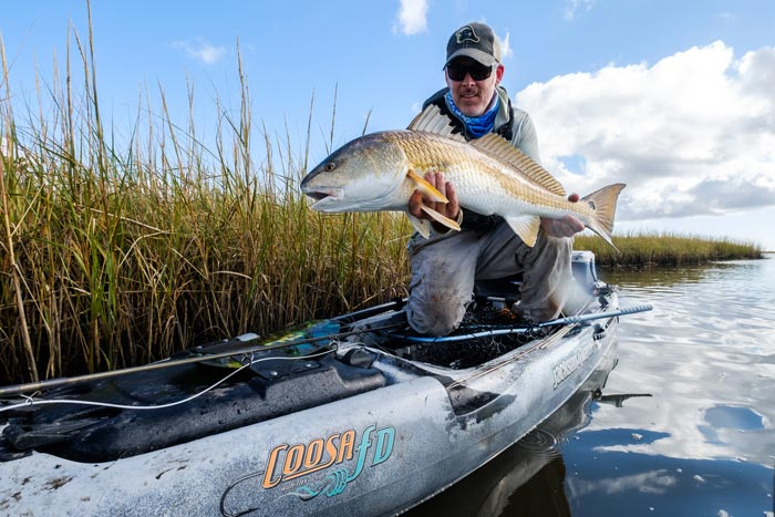 Photos a free pass for redfish on the louisiana marsh for Fly fishing new orleans